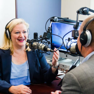 "Bonni Stachowiak, host of ""Teaching in Higher Ed"" recording her podcast"