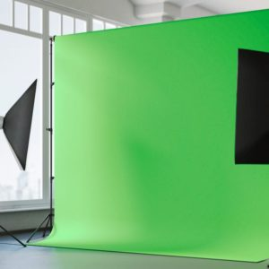 Green screen backdrop shown for video