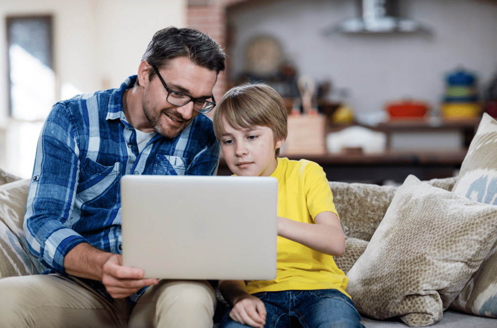 Dad teaches child in remote learning
